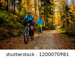 mountain biking woman and man... | Shutterstock . vector #1200070981