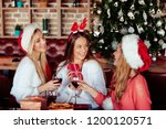 friends giving gifts to each...   Shutterstock . vector #1200120571