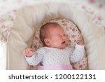 crying newborn girl | Shutterstock . vector #1200122131