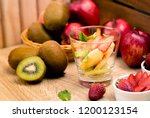 fruit salad cooking with apple... | Shutterstock . vector #1200123154