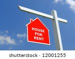 White wooden post with red House for Rent notice board over blue sky - stock photo