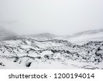 old lava field in snow. top of... | Shutterstock . vector #1200194014