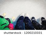 mother and kids skating... | Shutterstock . vector #1200210331