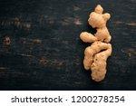 fresh ginger. on a black wooden ... | Shutterstock . vector #1200278254