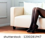 long woman legs in black tights ... | Shutterstock . vector #1200281947