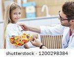 picture of male pediatrician... | Shutterstock . vector #1200298384