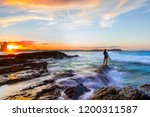 surfer standing on the end of a ... | Shutterstock . vector #1200311587