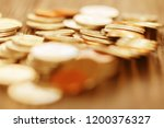 row of coins on wood background ... | Shutterstock . vector #1200376327