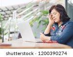 senior business women with a... | Shutterstock . vector #1200390274