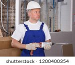 confident male contractor... | Shutterstock . vector #1200400354