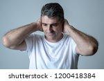 portrait of an attractive man... | Shutterstock . vector #1200418384