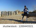 autumn seashore. woman chatting ... | Shutterstock . vector #1200445321