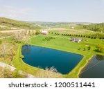 aerial of farmland and farm... | Shutterstock . vector #1200511441