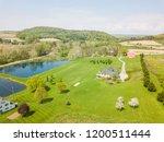 aerial of farmland and farm... | Shutterstock . vector #1200511444