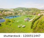 aerial of farmland and farm... | Shutterstock . vector #1200511447