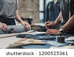 fashion designer working in his ... | Shutterstock . vector #1200525361