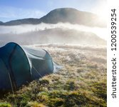 camping tent at a wild campsite ... | Shutterstock . vector #1200539254