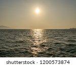 sunset over beach and aegean...   Shutterstock . vector #1200573874