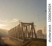a railway bridge in the morning ... | Shutterstock . vector #1200634024