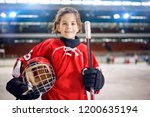 young girl hockey players in... | Shutterstock . vector #1200635194