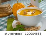 pumpkin soup in a white plate... | Shutterstock . vector #120064555
