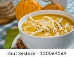 pumpkin soup in a white plate... | Shutterstock . vector #120064564