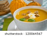 pumpkin soup in a white plate... | Shutterstock . vector #120064567