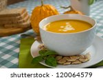 pumpkin soup in a white plate... | Shutterstock . vector #120064579