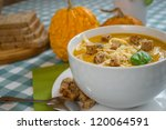 pumpkin soup in a white plate... | Shutterstock . vector #120064591