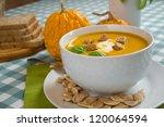 pumpkin soup in a white plate... | Shutterstock . vector #120064594