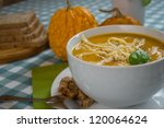 pumpkin soup in a white plate... | Shutterstock . vector #120064624