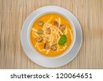 pumpkin soup in a white plate | Shutterstock . vector #120064651