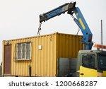 crane truck unloading portable... | Shutterstock . vector #1200668287