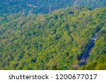 mountains roads daytime forest... | Shutterstock . vector #1200677017