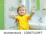 smiling child boy washing hands ... | Shutterstock . vector #1200711097