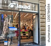 Small photo of Shopping. Exterior of Jaked store. Sport clothing. Competition swimwear, training swimsuits, swim goggles and caps, accessories. Italian market. Italy, Florence - April 17, 2018
