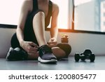 wonman sitting shoelaces with... | Shutterstock . vector #1200805477