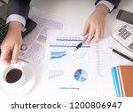 bisinessman working his job at... | Shutterstock . vector #1200806947