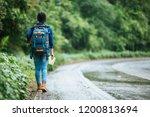 travelers walking along the... | Shutterstock . vector #1200813694