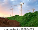 Construction site. Industrial landscape with cranes and pipe. - stock photo