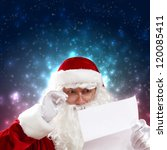 Santa holding Christmas letters and looking at camera - stock photo