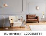 pink lamp next to armchair in... | Shutterstock . vector #1200868564
