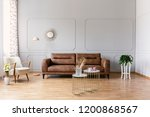 gold tables in front of leather ... | Shutterstock . vector #1200868567