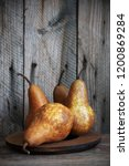 Whole Brown Pears On Rustic...