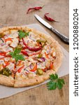 traditional spicy pizza with... | Shutterstock . vector #1200880204
