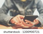 woman hand using smartphone and ... | Shutterstock . vector #1200900721