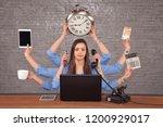 multitask businesswoman sat at...   Shutterstock . vector #1200929017
