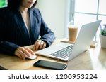 business woman working in... | Shutterstock . vector #1200953224