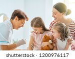 a doctor making a vaccination... | Shutterstock . vector #1200976117