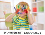 cute cheerful kid with hands... | Shutterstock . vector #1200992671